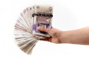 Cash in hand: Source - FreeDigitalPhotos.net